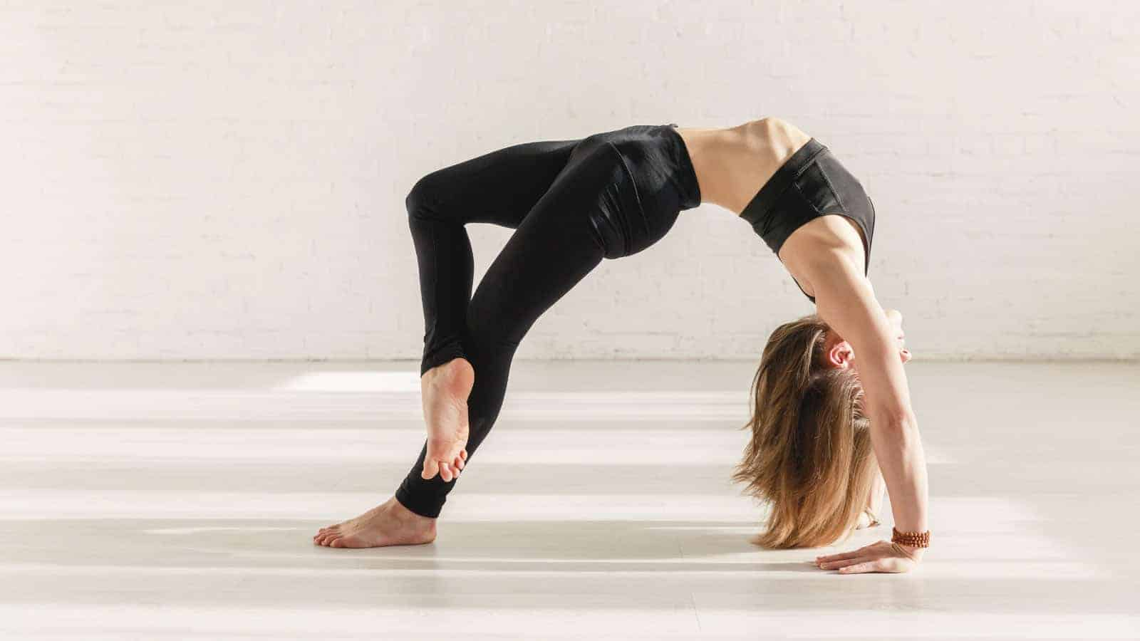 straighten arms in wheel pose